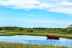 Herring River Cape Cod. The Herring River in Harwich, Massachusetts, has been of vital importance to three Cape Cod industries, cranberries, ship building, and Stock Image
