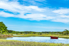Herring River Cape Cod. The Herring River in Harwich, Massachusetts, has been of vital importance to three Cape Cod industries, cranberries, ship building, and Royalty Free Stock Photos