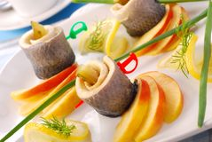 Herring rolls with apple Stock Photography