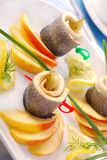 Herring rolls with apple Stock Photo