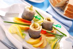 Herring rolls with apple Royalty Free Stock Images