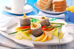 Herring rolls with apple Stock Photos