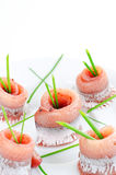 Herring rolls with spring onion Stock Photo