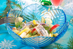 Herring salad with apple and potato. Herring salad with apple,potato,gherkin and dill in blue glass bowl for christmas Stock Image
