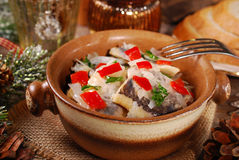 Herring salad for christmas on wooden table Stock Image