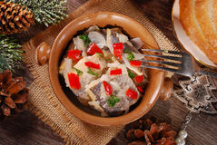 Herring salad for christmas on wooden table Stock Images