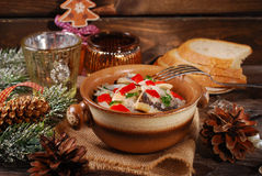 Herring salad for christmas on wooden table Royalty Free Stock Photography
