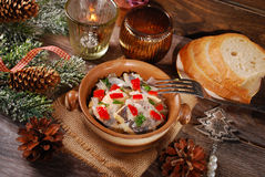 Herring salad for christmas on wooden table Stock Photography