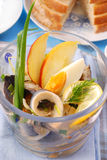 Herring salad in glass bowl Royalty Free Stock Images