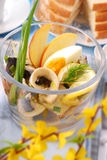 Herring salad in glass bowl for easter Royalty Free Stock Photography