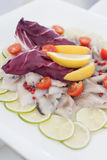 Herring salad with lime, radicchio and cherry tomatoes. Stock Photo