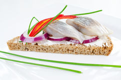 Herring sandwich on rye bread Royalty Free Stock Image