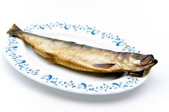 Herring smoked on plate. And on white background Royalty Free Stock Photo