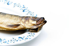 Herring smoked on plate. And on white background Royalty Free Stock Images