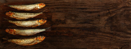 Herring sprats smoked wooden table stock images