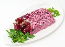 Herring under beetroot salad Royalty Free Stock Image