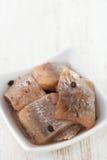 Herring in white dish Stock Photos