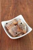 Herring in white dish Stock Photo