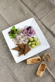 Herring with young potatoes, onions and toasts. Delicious dish with herring, young potatoes, onions and toasts.  Food decoration. Food beauty. Food art Stock Photo