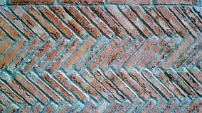 Herringbone brick pattern wall. Cement pointing stock photo