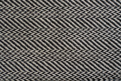 Herringbone Broken Twill Weave fabric. Herringbone Broken Twill Weave - a distinctive V-shaped weaving pattern. Closeup. Grey textured background Royalty Free Stock Photos