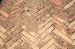 Herringbone flooring texture. Texture of ancient herringbone tiled flooring Stock Photo