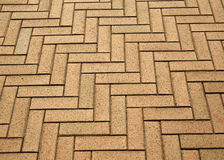 Herringbone pattern of the artificial paver blocks Stock Photo