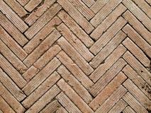 Herringbone pattern brickwall Stock Images