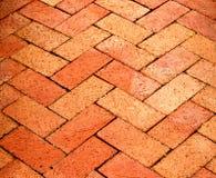 Herringbone Patterned Bricks. Red bricks form a herringbone patterned walkway Royalty Free Stock Image