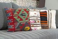 Herringbone sofa with traditional Turkish handmade colorful natural fabric pillows Royalty Free Stock Photo