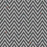 Herringbone Tweed pattern in greys repeats Royalty Free Stock Images