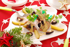 Herrings with prune and gherkin. Plate of herrings appetizer with prune and gherkin in mustard sauce for christmas Stock Photography