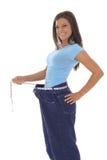 Herrliche Frau, die ihren Gewichtverlust vorführt Lizenzfreie Stockfotos