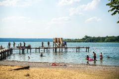 Families swimming in lake. Herrsching,Germany-August 20,2018: Families go swimming in Ammersee lake in a hot summer afternoon stock images
