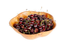 Сherry berries in wooden bowl isolated on white Stock Photo