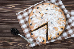 Сherry pie sprinkled powdered sugar on wooden background Stock Image