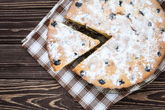 Сherry pie sprinkled powdered sugar on wooden background Stock Photography