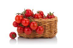 Сherry tomatoes isolated in a basket. Photo depicting the composition of the basket of tomatoes Stock Photo