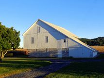 Old White Barn in Hershey, Pennsylvania. Hershey, Pennsylvania farm with old white barns, scene of rural country life stock image