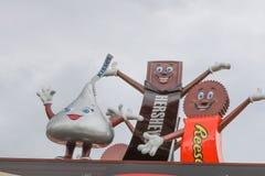 Visitors entering the immense Hershey`s Chocolate World super store. Hershey, Pennsylvania - November 3, 2017: Visitors entering the immense Hershey`s Chocolate Stock Photo