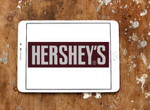 Hershey`s chocolate logo. Logo of chocolate brand hershey`s on samsung tablet on wooden background Royalty Free Stock Images