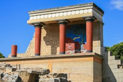 Travel around Europe by car. An ancient ruins of Greek Knossos palace and group of tourists. 09.23.2008, Hersonissos, Crete, Greece. Travel around Europe by car stock photo