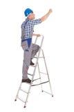 Hersteller die stapladder beklimmen royalty-vrije stock fotografie
