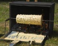 Herstellung des Baumkuchens Stockfotografie