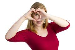 Herstellung eines Herzens mit ihren Händen Lizenzfreies Stockfoto