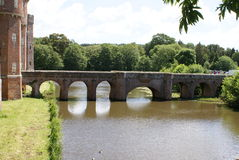 Herstmonceux Castle' bridge over a moat in England Royalty Free Stock Photo