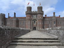 Herstmonceux Castle red brick built and flag stone pathway entrance. Earliest examples of a red brick built building in England, very old building in UK, turrets Royalty Free Stock Photos