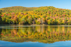 Hertel Lake in Quebec with Autumn colors Royalty Free Stock Photo