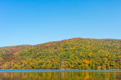 Hertel Lake in Quebec with Autumn colors Stock Photo