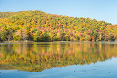 Hertel Lake in Quebec with Autumn colors Stock Images